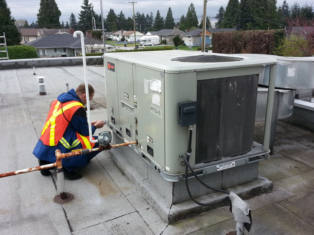 Field review of a rooftop air handling unit.